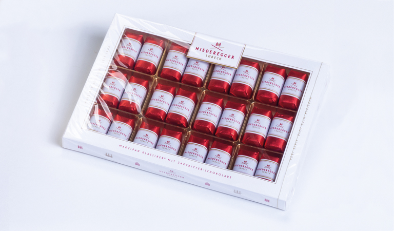 Classic marzipan pralines from Niederegger in a confectionery box.