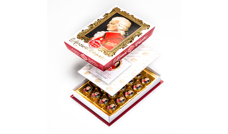 An intricate box of pralines from Reber with Mozart-Kugeln® packed using pick and place technology.